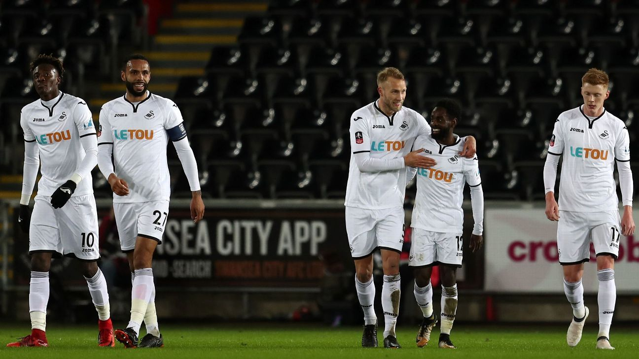 Nathan Dyer, centre, celebrates with teammates after scoring a goal for Swansea against Notts County.