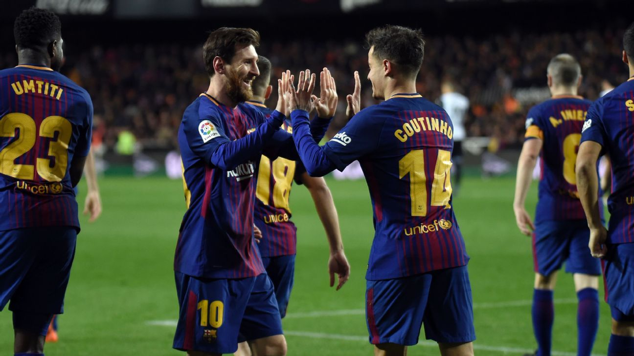 Lionel Messi, left, congratulates Philippe Coutinho after the new arrival scored his first goal for Barcelona.