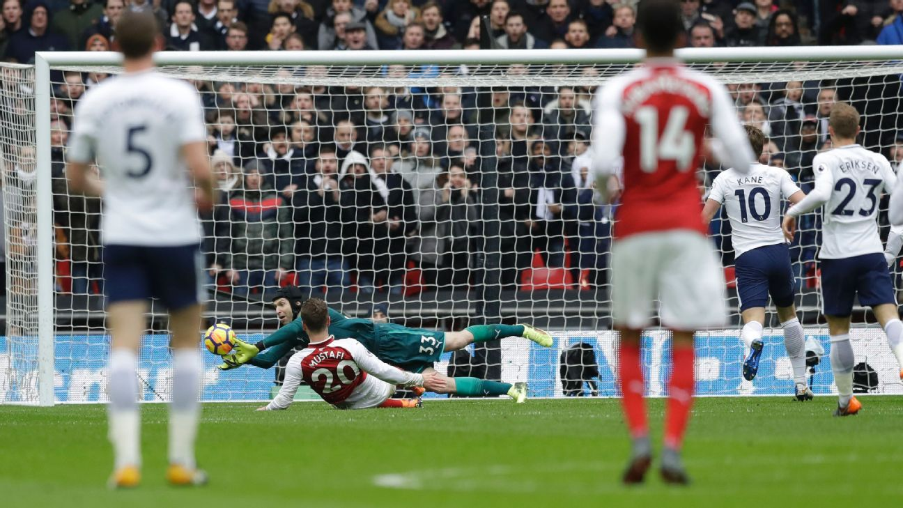Petr Cech saves a shot from Harry Kane during Arsenal's Premier League game against Tottenham.