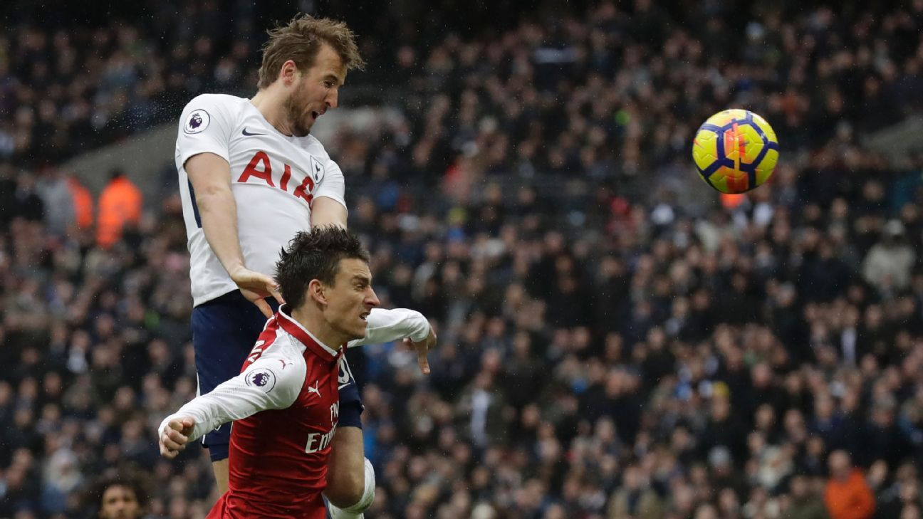 Harry Kane leaps above Laurent Koscielny to give Tottenham the lead against Arsenal.