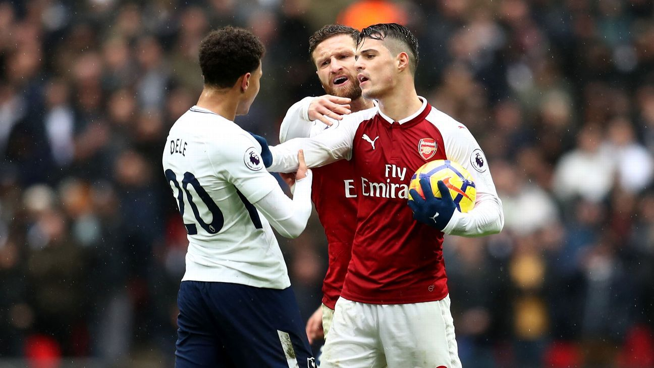 Dele Alli and Granit Xhaka during Tottenham's Premier League game against Arsenal at Wembley.