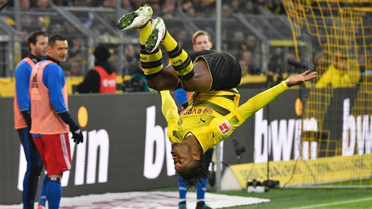 Michy Batshuayi celebrates after opening the scoring in Borussia Dortmund's Bundesliga win against Hamburg.