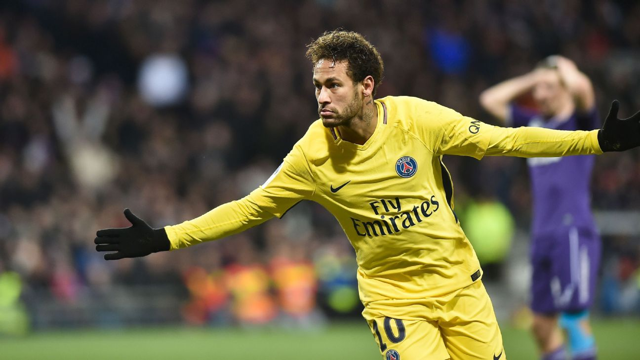 Neymar celebrates after scoring a goal for PSG in a win against Toulouse.