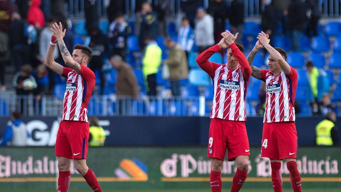 Atletico Madrid celebrate their 1-0 win over Malaga in La Liga.