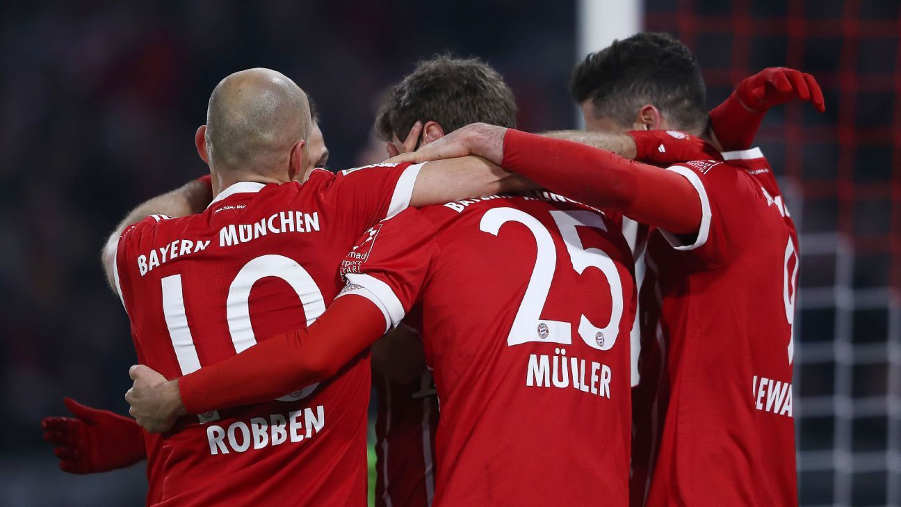 Thomas Muller celebrates with his Bayern Munich teammates after scoring a goal against Schalke.