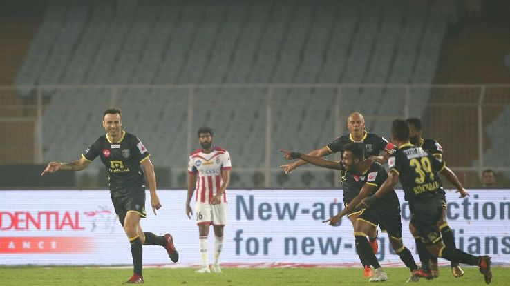 Dimitar Berbatov (extreme left) celebrates after scoring a goal against ATK.