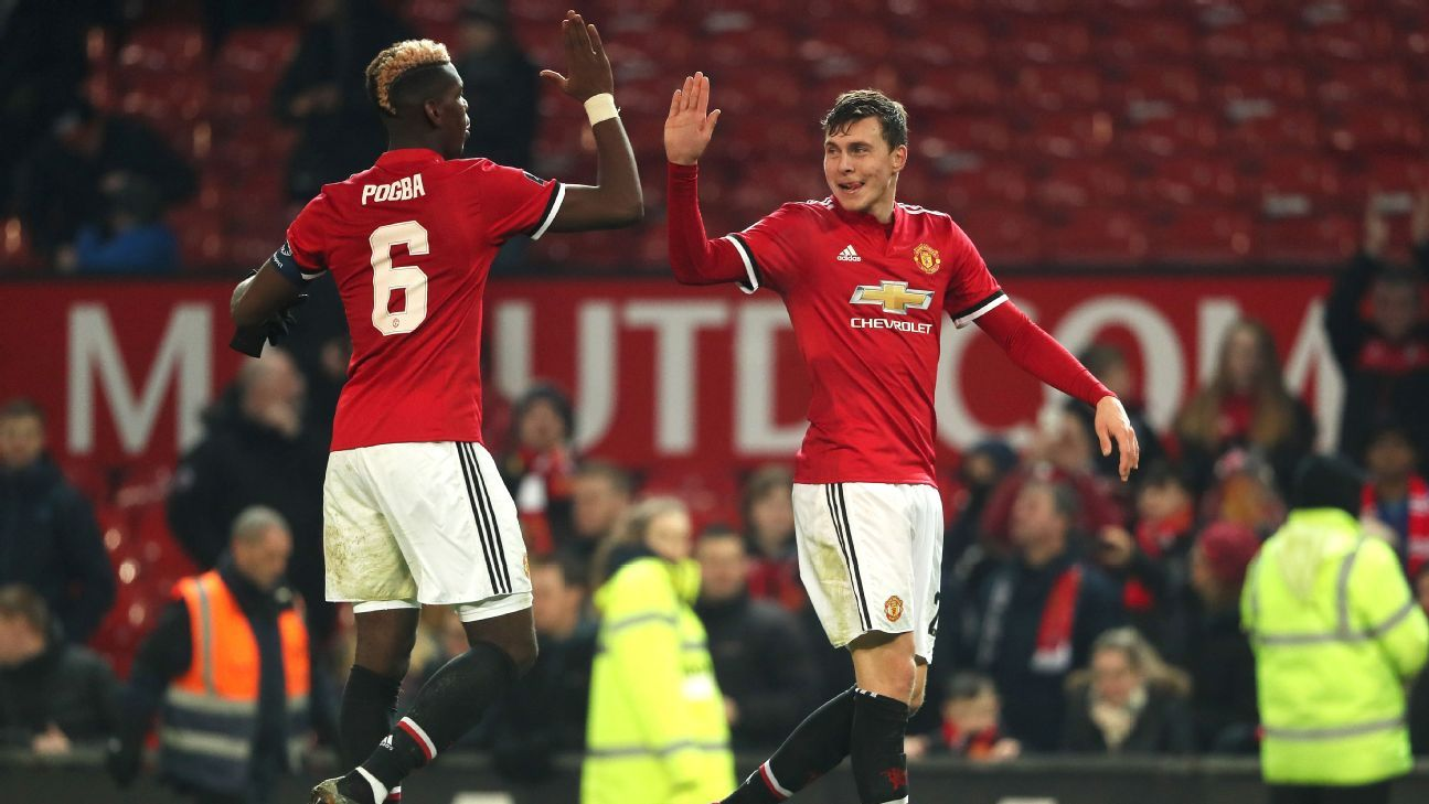 Paul Pogba, left, and Victor Lindelof celebrate during Man United's win against Derby County.