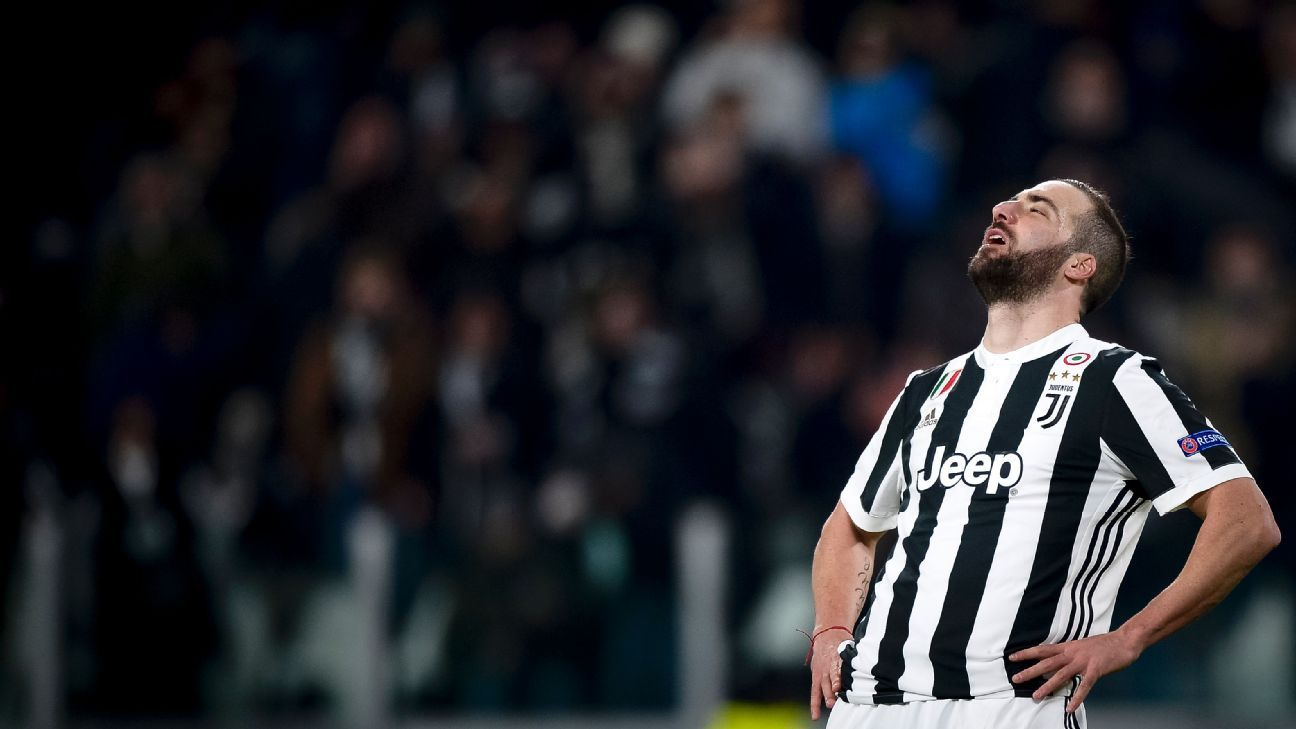 Gonzalo Higuain reacts after missing a penalty against Tottenham.