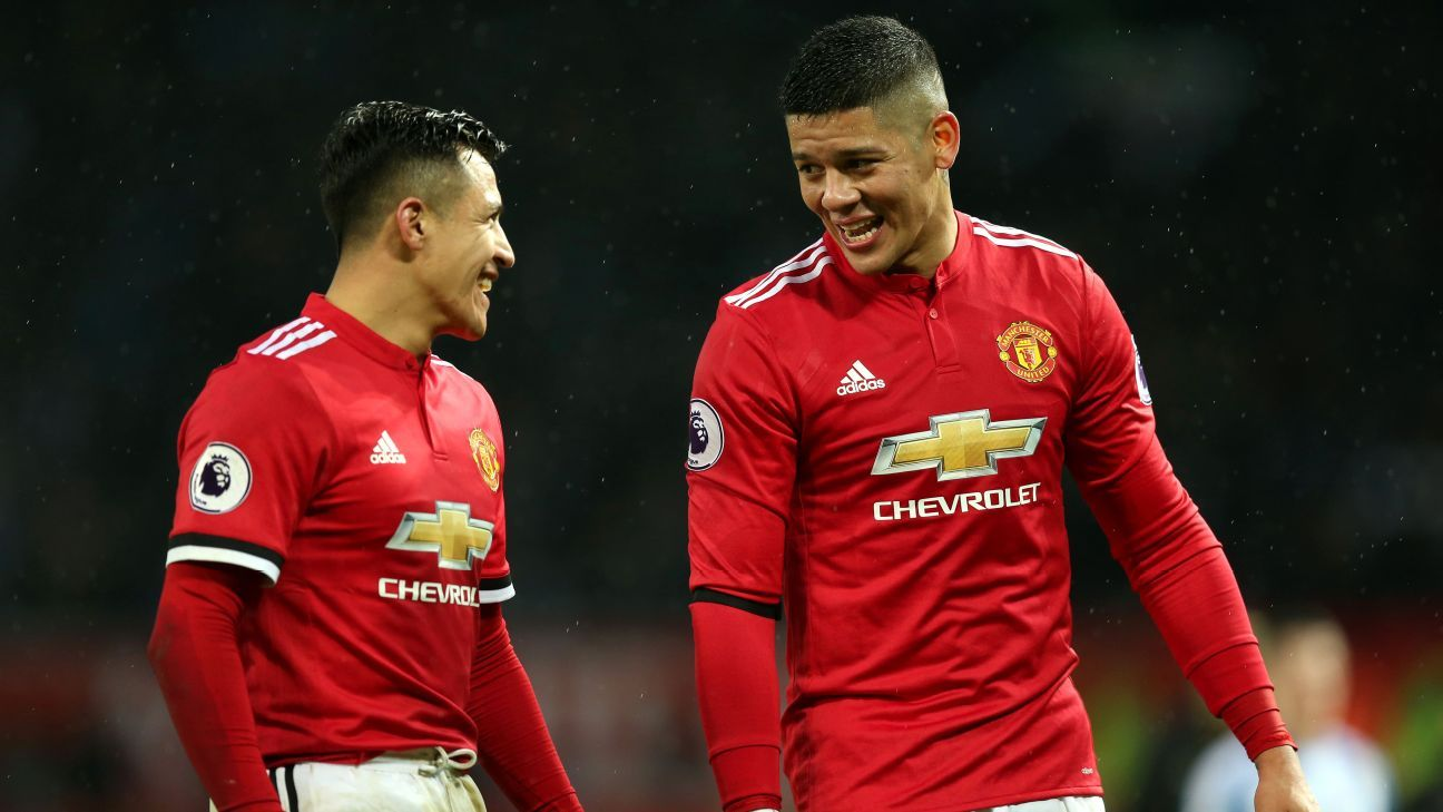 Alexis Sanchez and Marcos Rojo after Manchester United's Premier League win against Huddersfield.