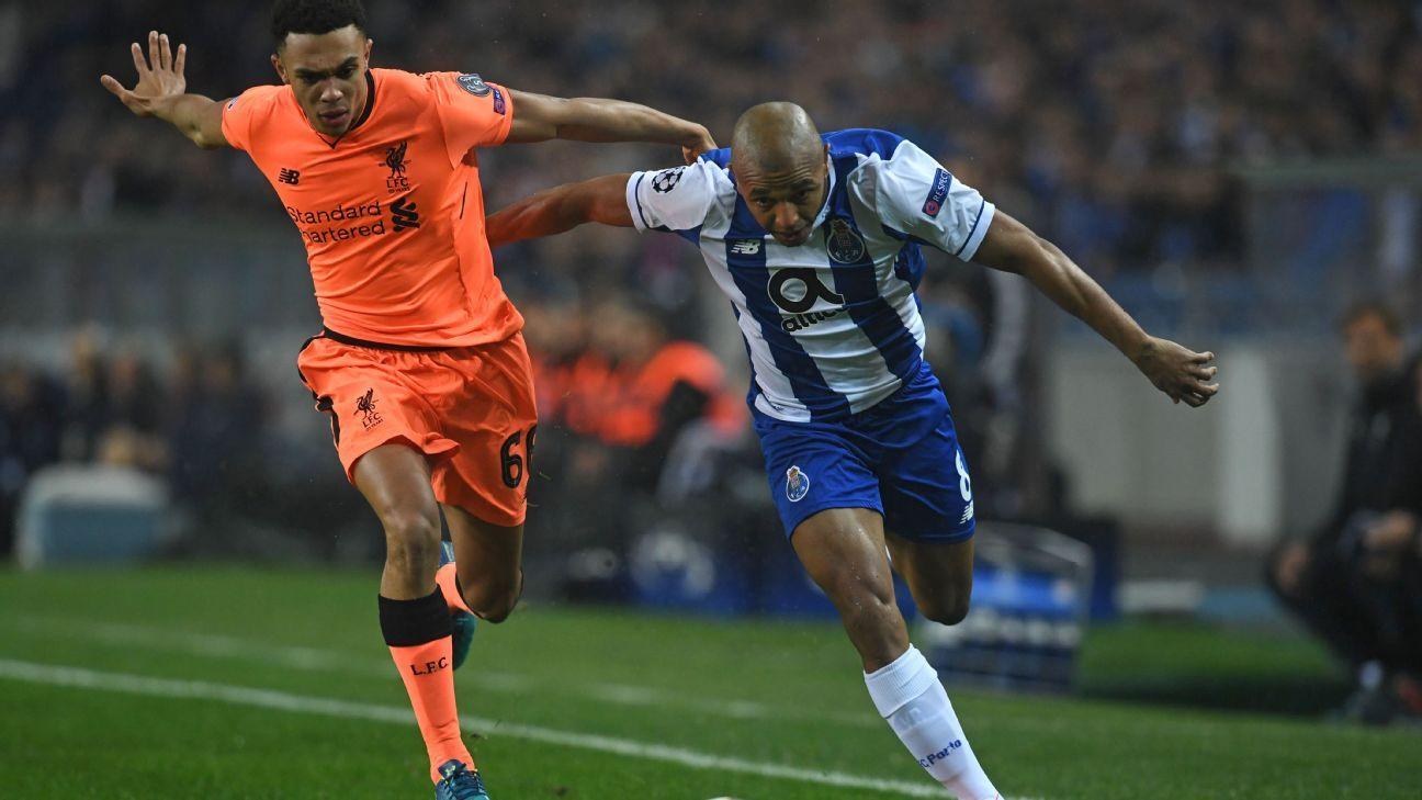 Trent Alexander-Arnold vies with Porto's Yacine Brahimi.