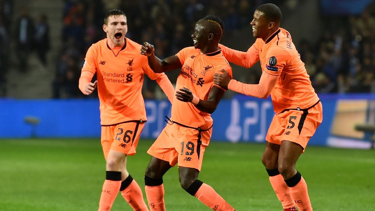 Liverpool celebrate their opening goal.