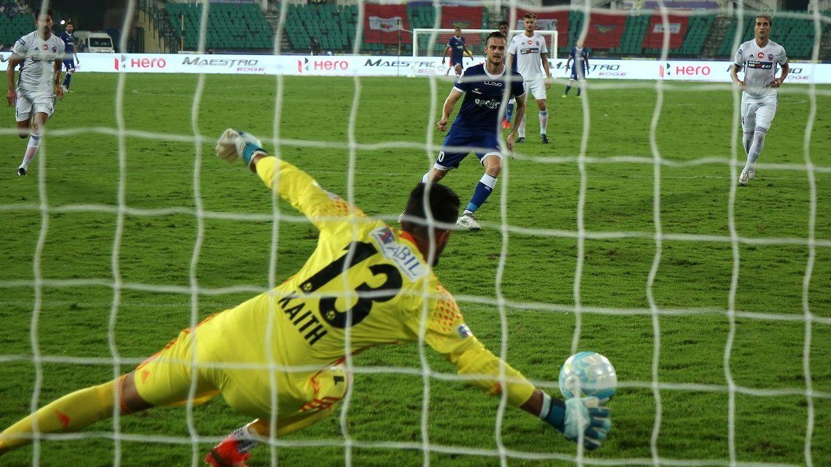 Vishal Kaith saves a penalty against Chennaiyin's Rene Mihelic.
