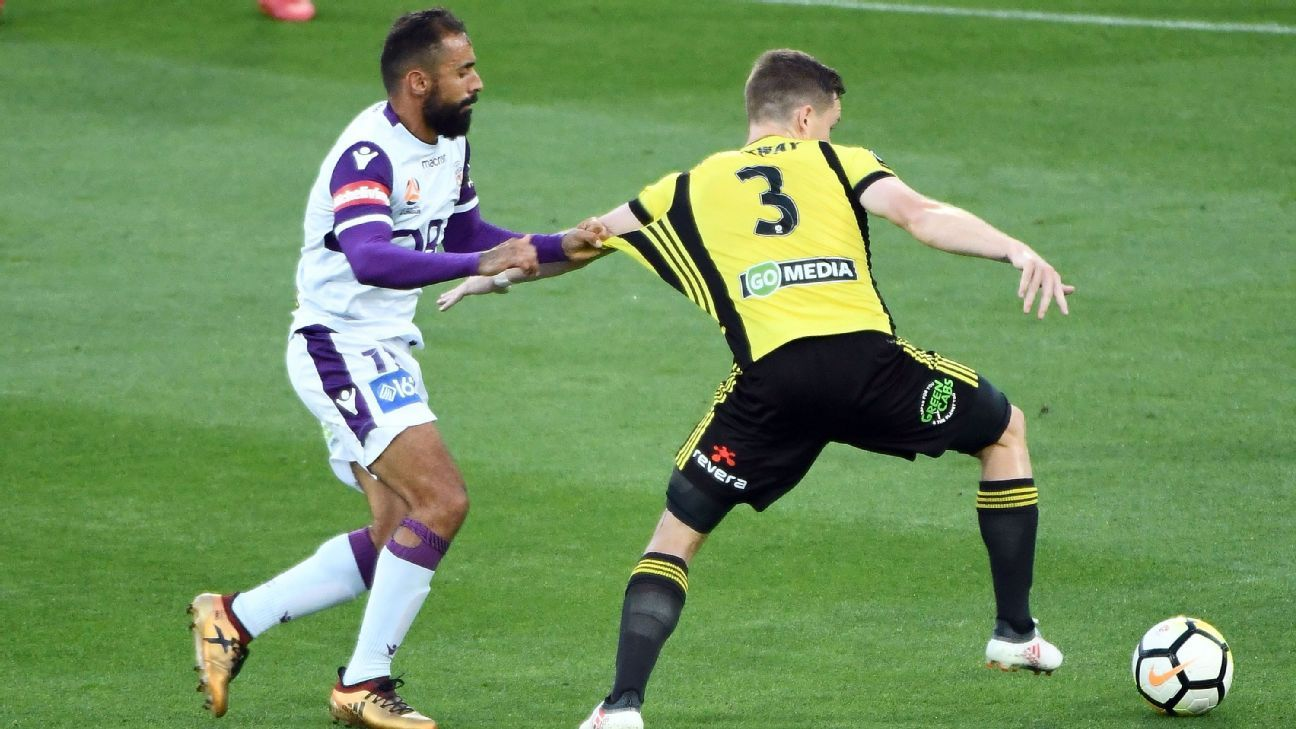 Perth Glory's Diego Castro grabs short of Wellington Phoenix's Scott Galloway during A-League clash
