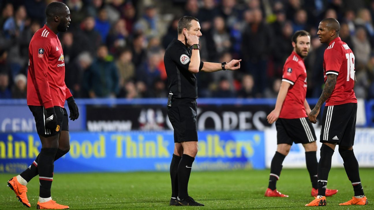 Kevin Friend makes a VAR decision during Manchester United's FA Cup tie against Huddersfield.