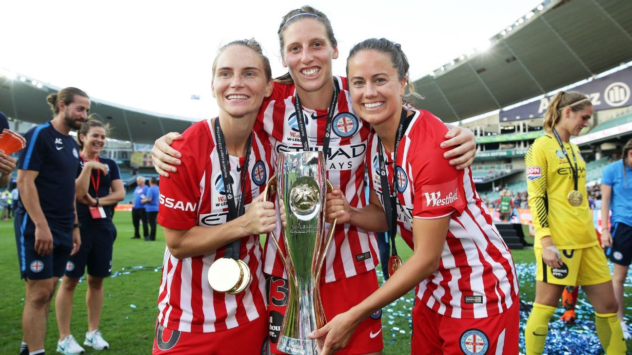 Melbourne City's Jessica Fishlock, Rebekah Stott and Lauren Barnes celebrate winning W-League grand final