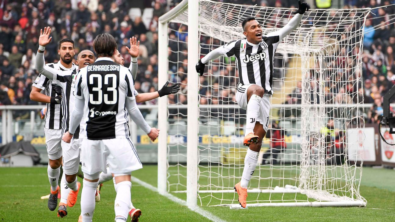Alex Sandro celebrates after scoring for Juventus in their Serie A match against Torino.