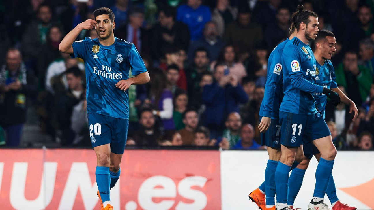 Marco Asensio celebrates after scoring the opener for Real Madrid against Real Betis.