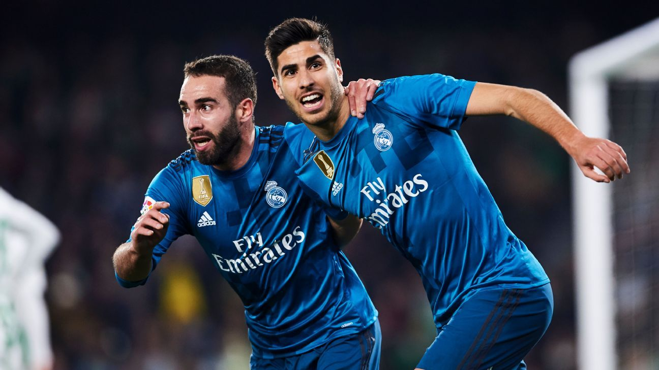 Dani Carvajal, left, and Marco Asensio celebrate after combining for a Real Madrid goal against Betis.