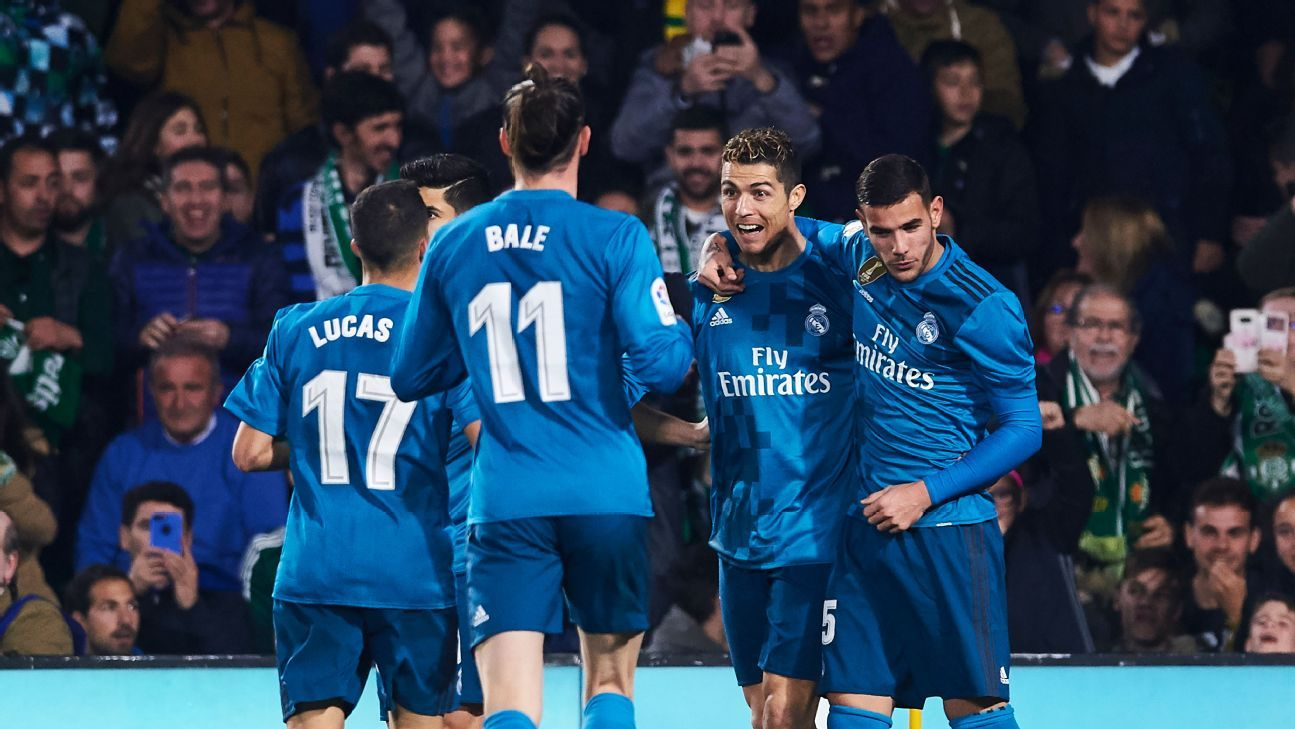 Cristiano Ronaldo celebrates with his Real Madrid teammates after scoring a goal.
