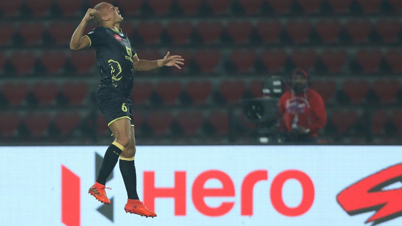 Wes Brown celebrates after scoring against NorthEast United.