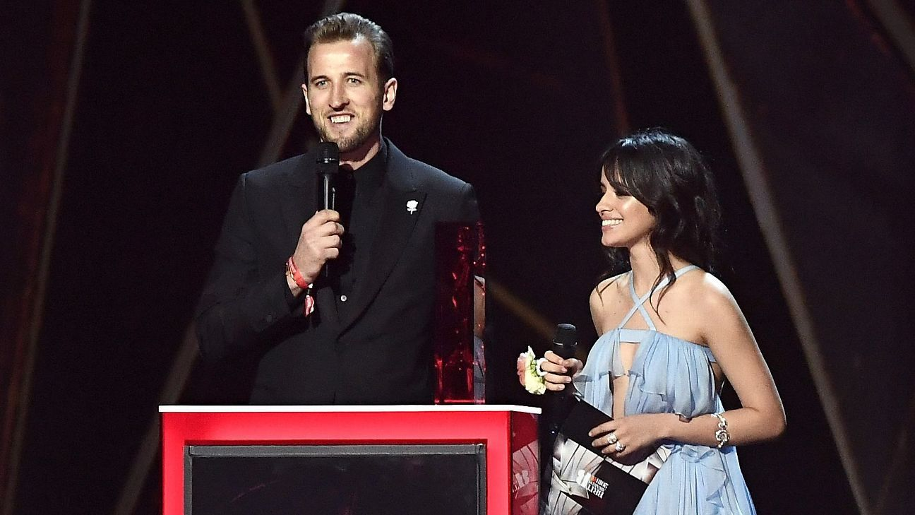 Harry Kane presents a BRIT award with Camila Ceballo