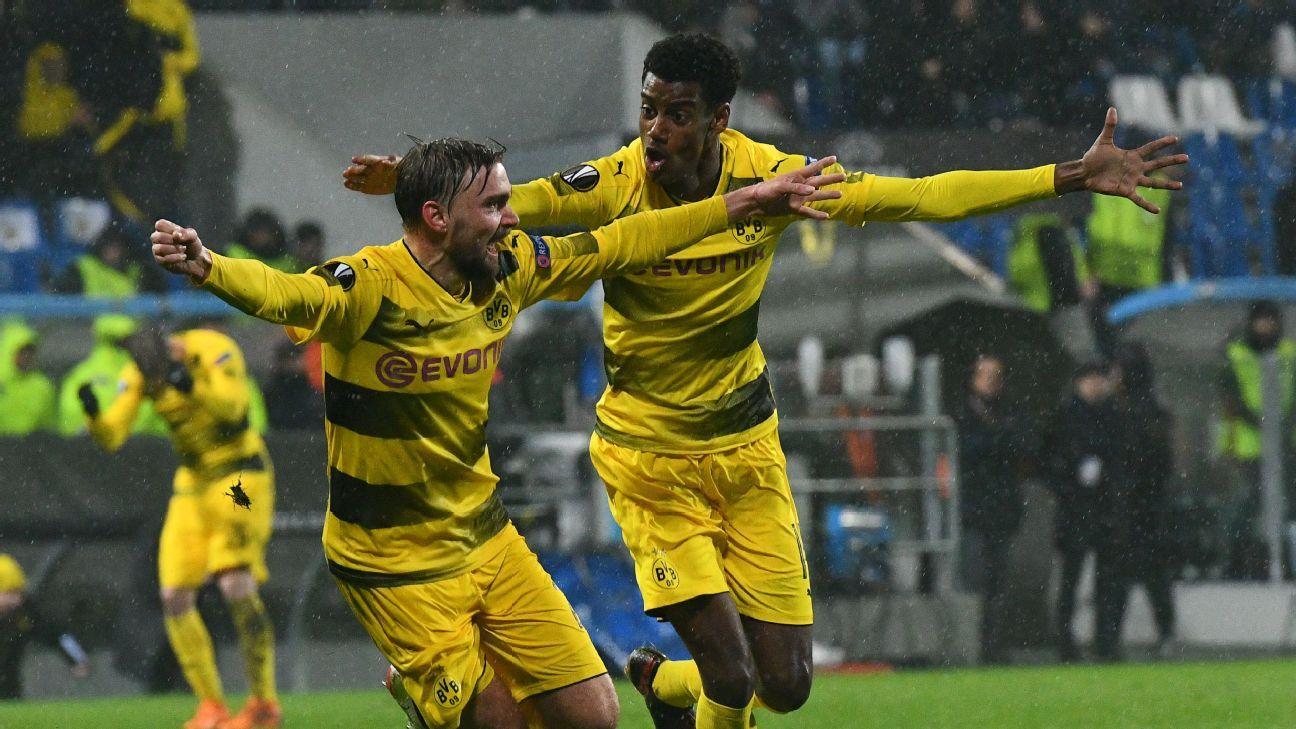 Dortmund's Marcel Schmelzer, left, celebrates after scoring a goal for Dortmund in the Europa League.