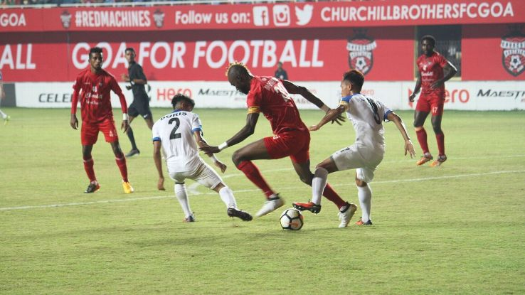 Yet to reach their physical peak, Arrows players (in white) often have to rely on their work rate and organisation against their bigger opponents.