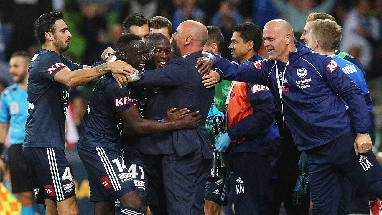 Melbourne Victory's Leroy George celebrates goal with teammates and coach Kevin Muscat