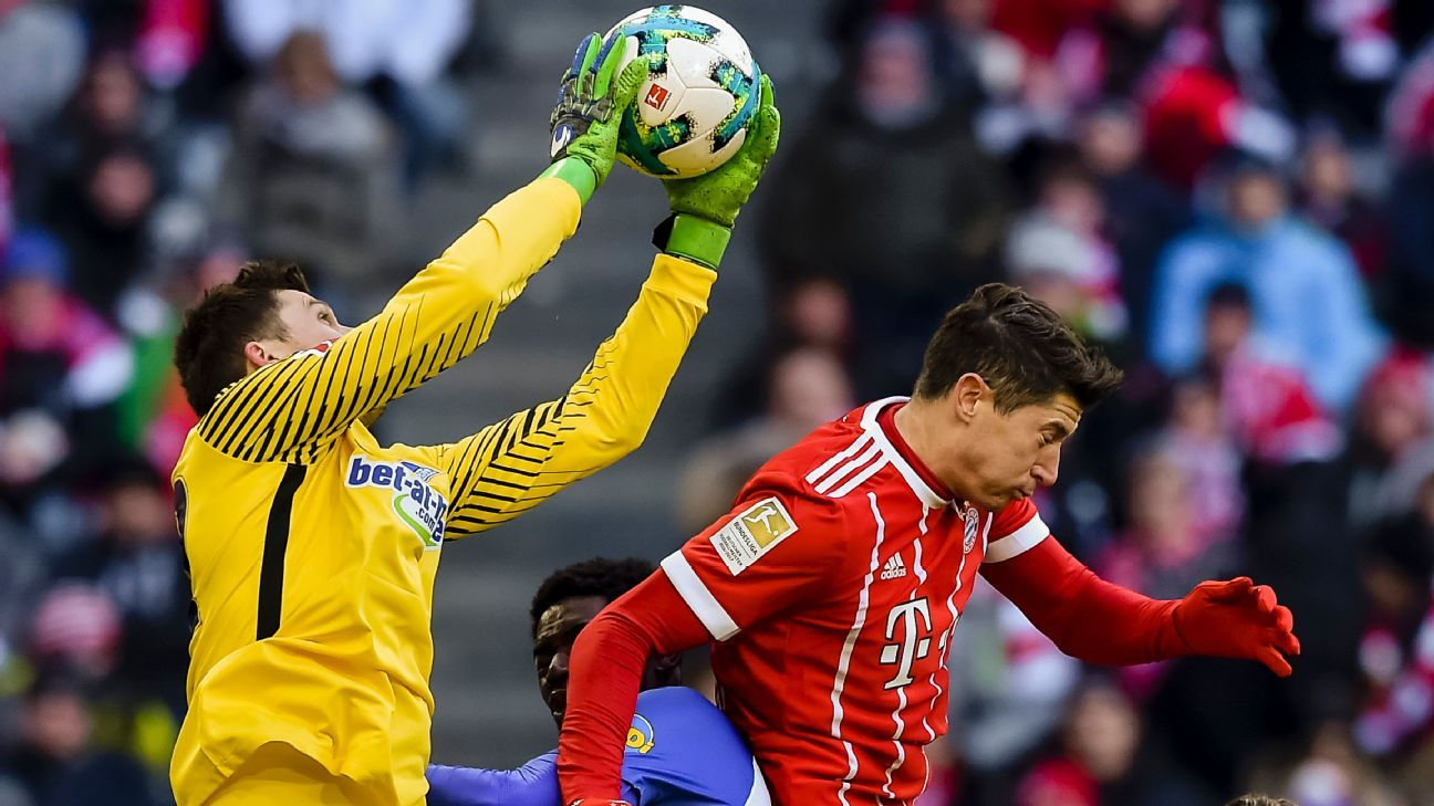 Hertha Berlin goalkeeper Rune Jarstein and Bayern Munich striker Robert Lewandowski jump for the ball