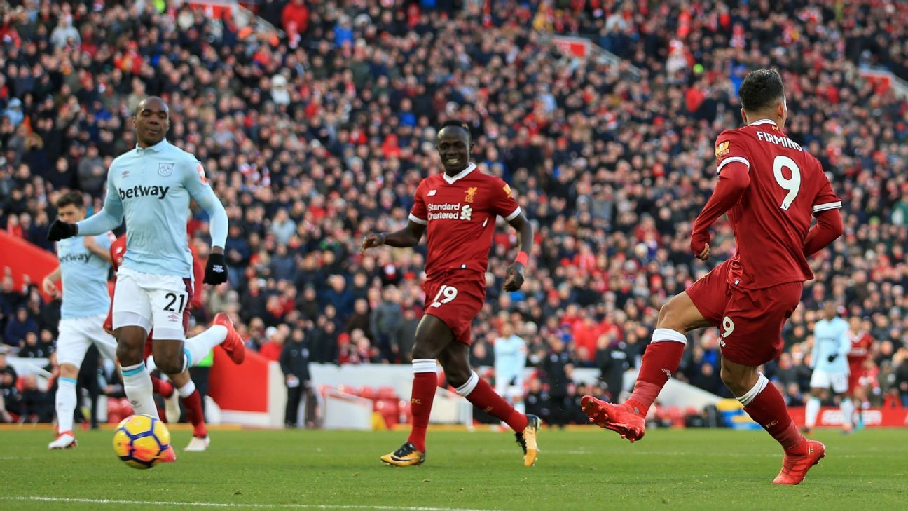 Liverpool's Roberto Firmino looks other way as he scores vs West Ham