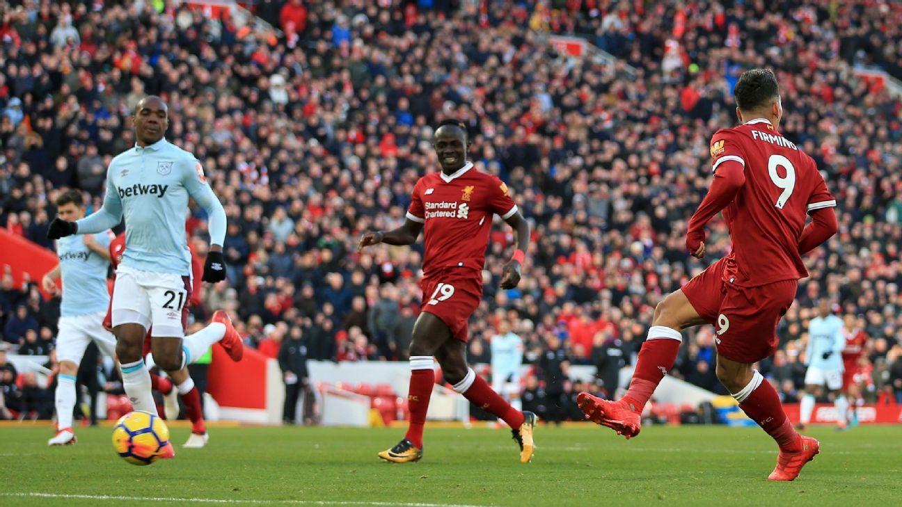 Liverpool's Roberto Firmino looks other way as he scores vs West Ham