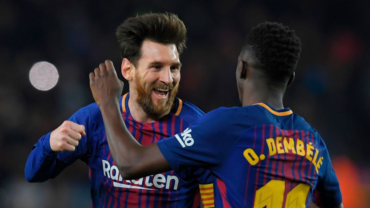 Lionel Messi celebrates his second goal of the night with Ousmane Dembele.