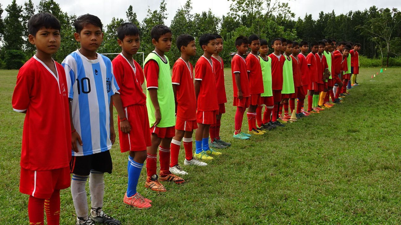 The boys line up: the Kamrupa Football Coaching Centre's youngest batch of under-13s during weekend training at the Jantha Sangha playground in Bondapara, Assam.