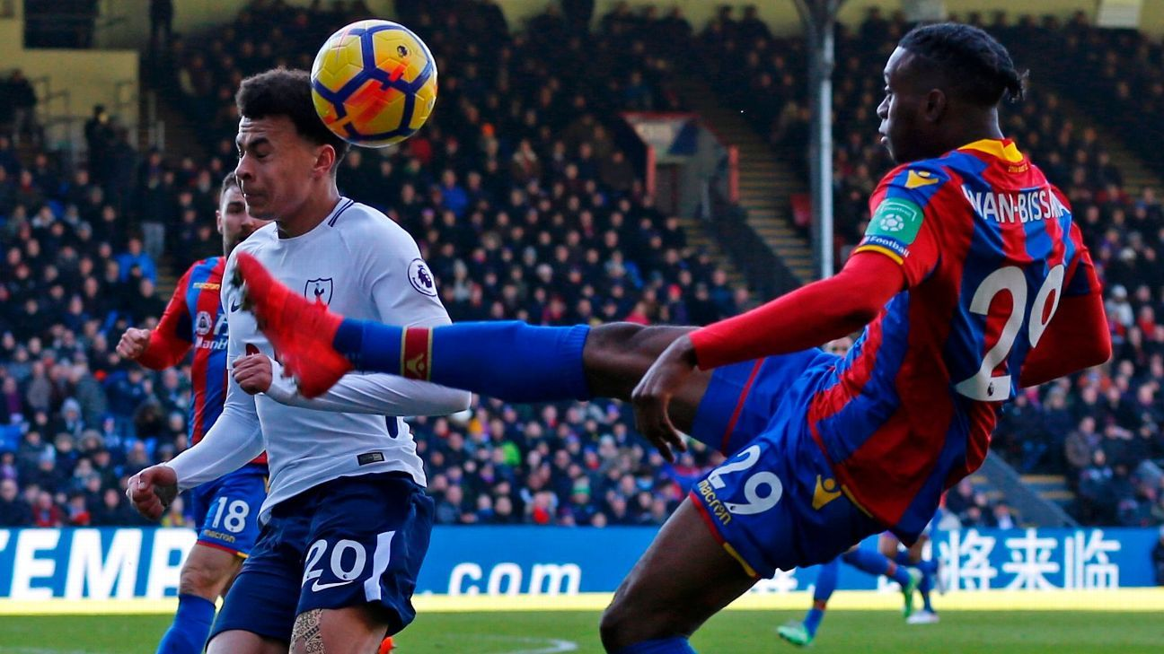 Crystal Palace's Aaron Wan-Bissaka and Tottenham Hotspur's Dele Alli battle for the ball
