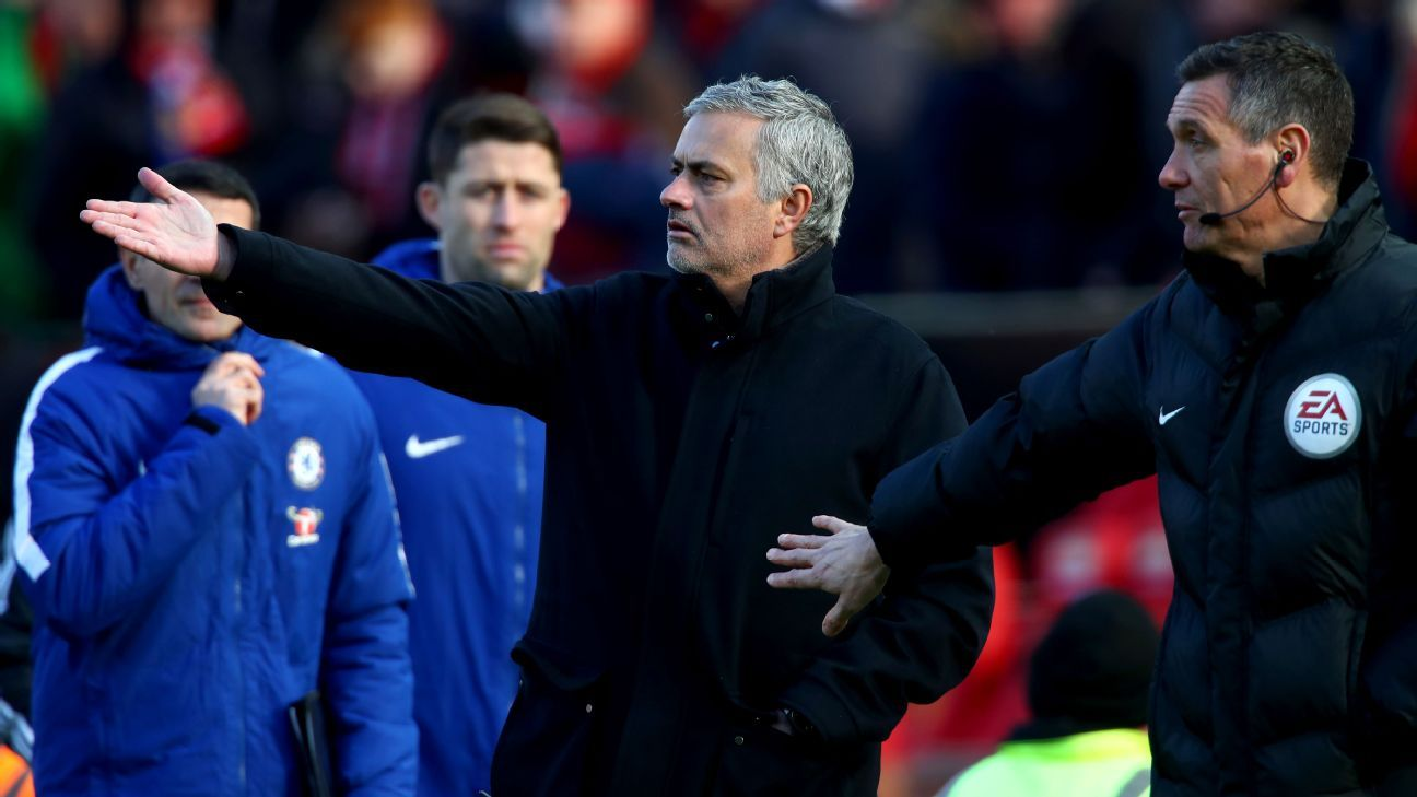 Manchester United's Jose Mourinho and  fourth official Andre Marriner