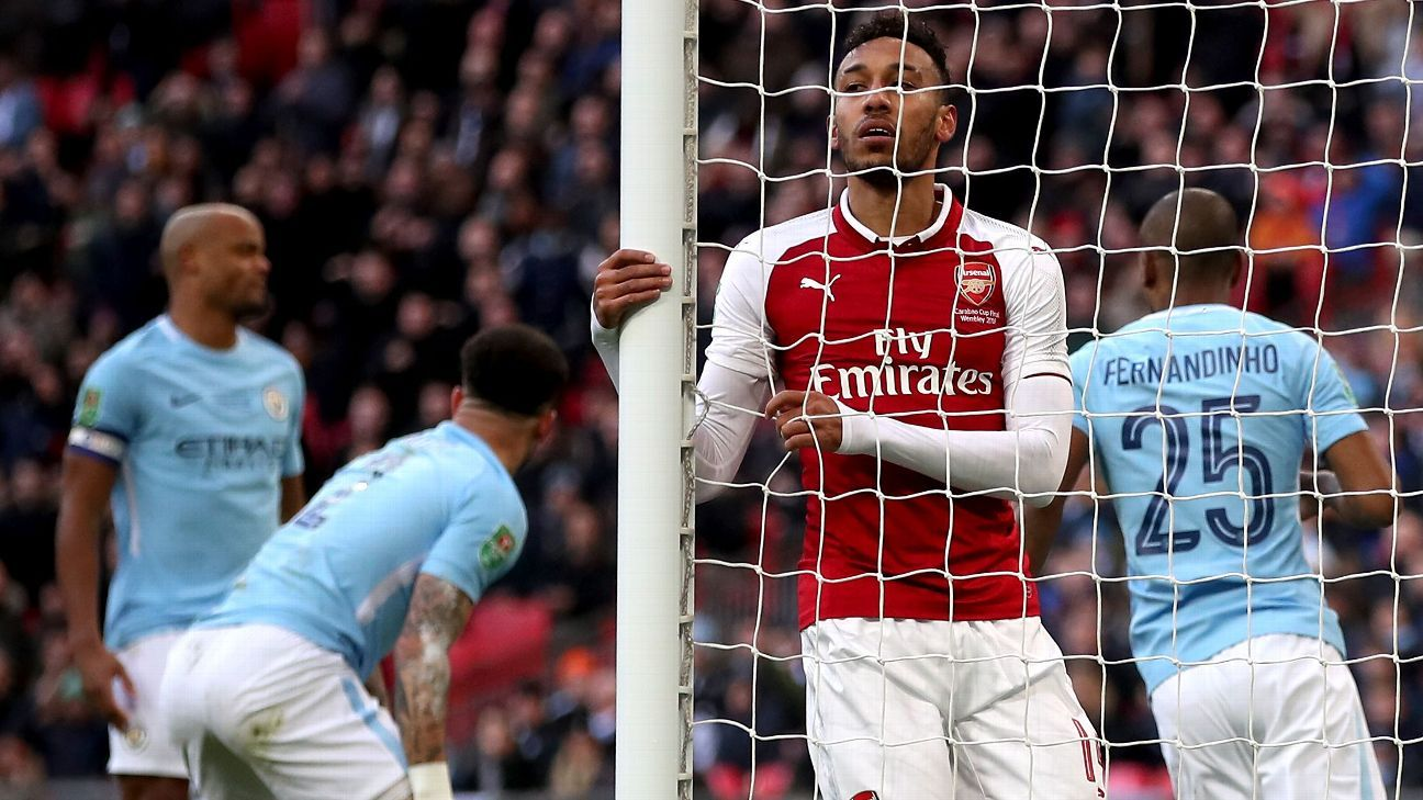 Arsenal's Pierre-Emerick Aubameyang reacts to miss vs Manchester City