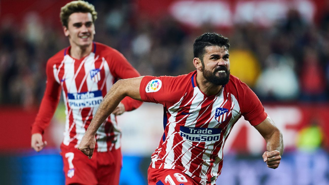 Diego Costa celebrates after scoring a goal for Atletico Madrid against Sevilla.