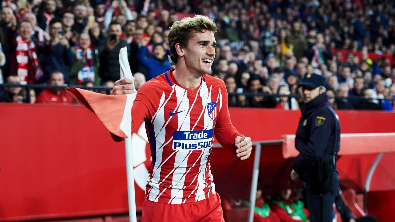 Antoine Griezmann celebrates after scoring a goal for Atletico Madrid against Sevilla.
