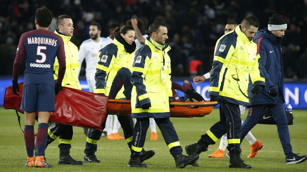Neymar is stretchered off after suffering an injury in PSG's win against Marseille.