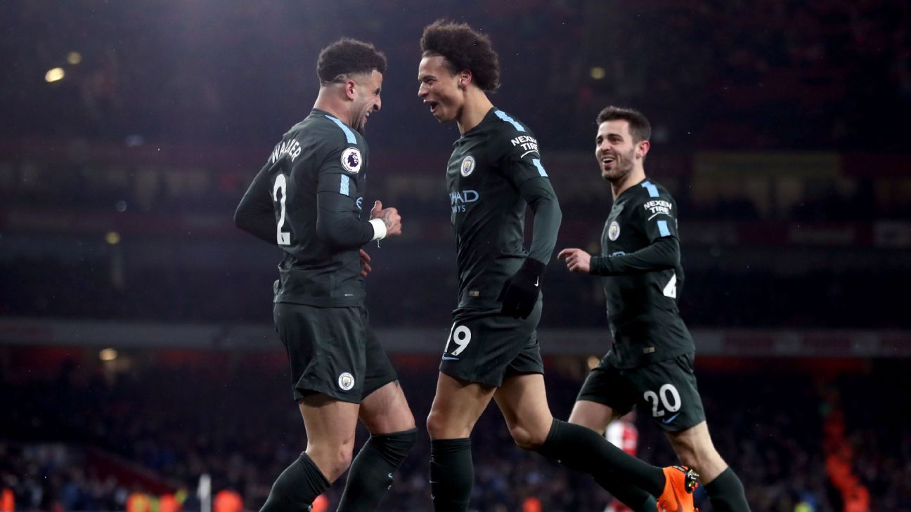 Manchester City's Leroy Sane, centre, celebrates scoring his side's third goal of the game at Arsenal.