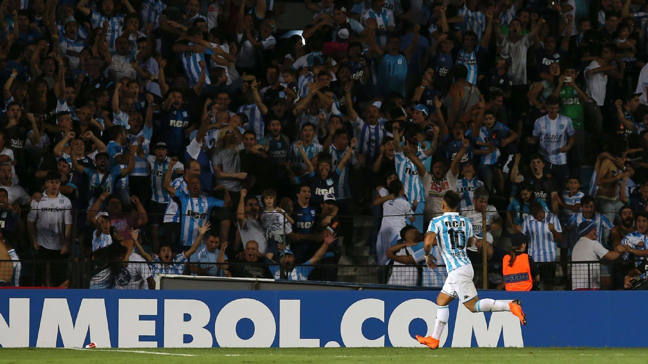 Lautaro Martinez of Racing celebrates after scoring the third goal for his team against Cruzeiro.