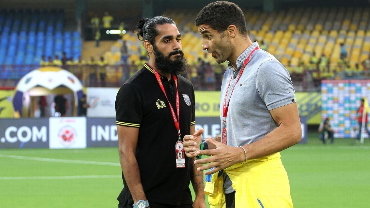 Sandesh Jhingan and David James engaged in a pre-match discussion.