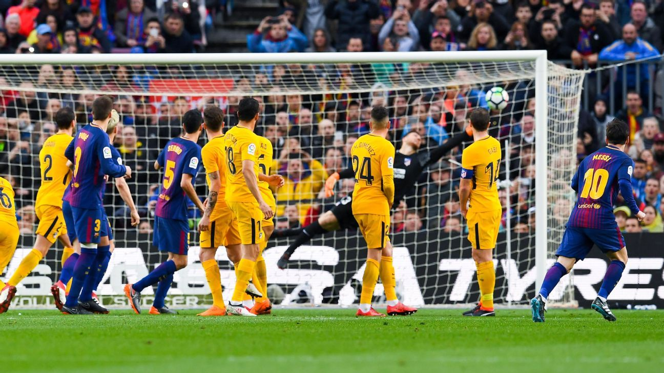 Lionel Messi scores the opener for Barcelona against Atletico Madrid.