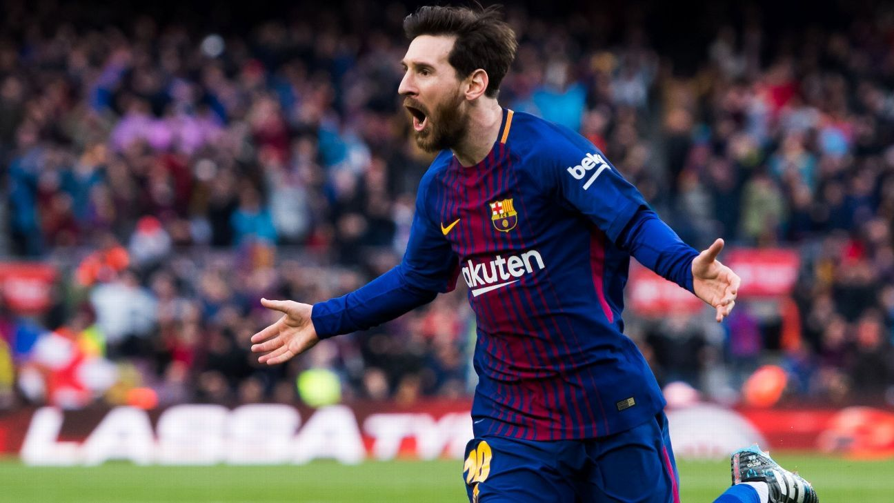 Lionel Messi celebrates his free kick against Atletico Madrid.