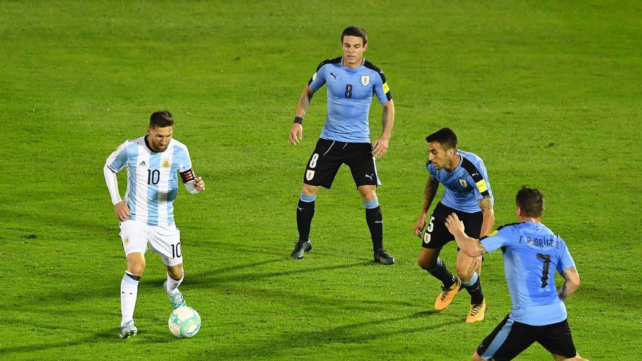 Lionel Messi dribbles for Argentina against Uruguay.