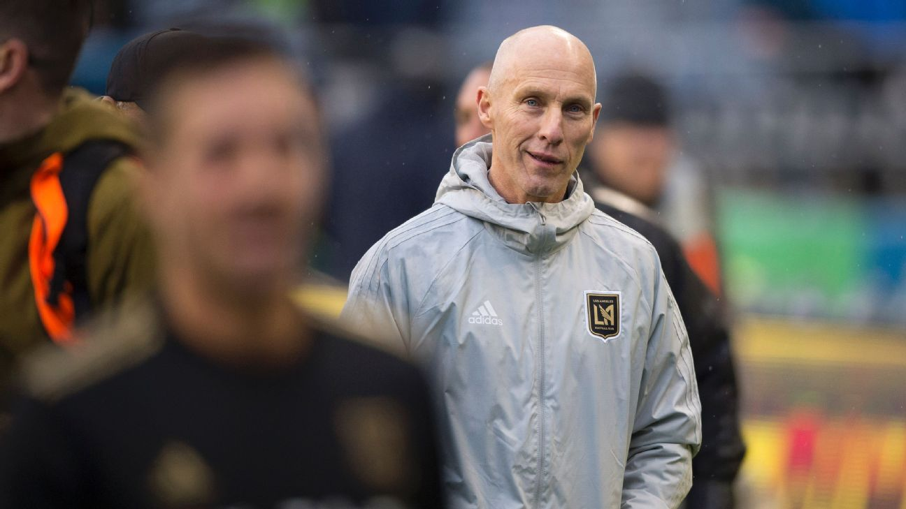 Bob Bradley leaves the field after overseeing LAFC's win against the Seattle Sounders.