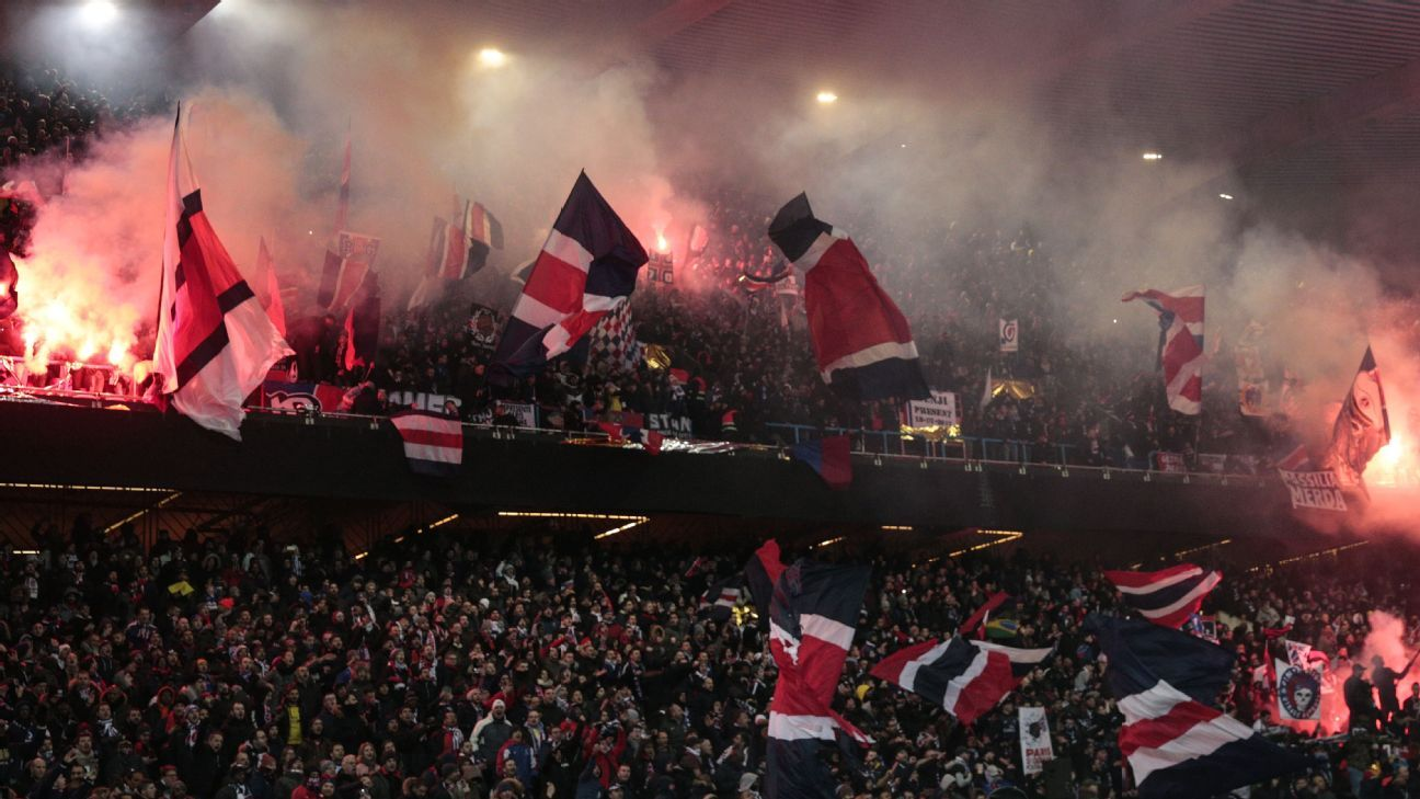 Paris Saint-Germain fans let off flares during match against Marseille at Parc des Princes