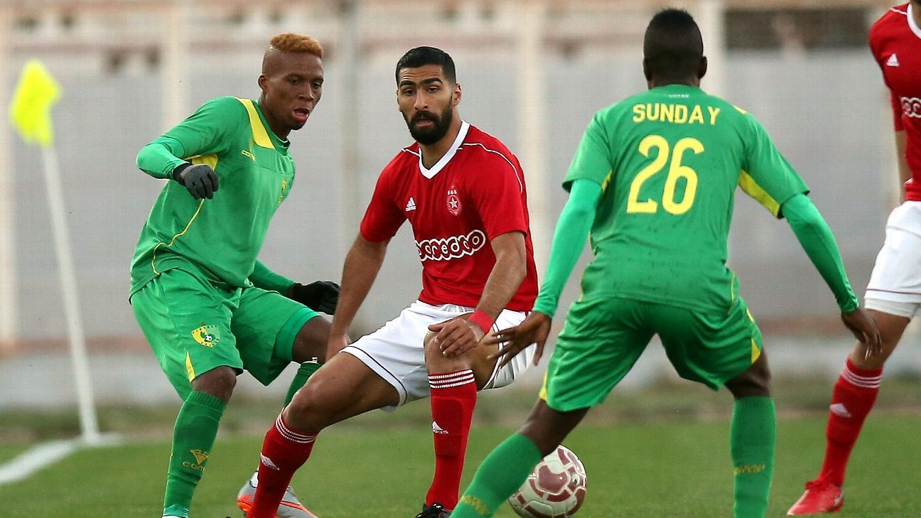 Etoile Sportive du Sahel's Mohamed Methnani and Tosin Omoleye & Sunday Ngbede of Plateau United