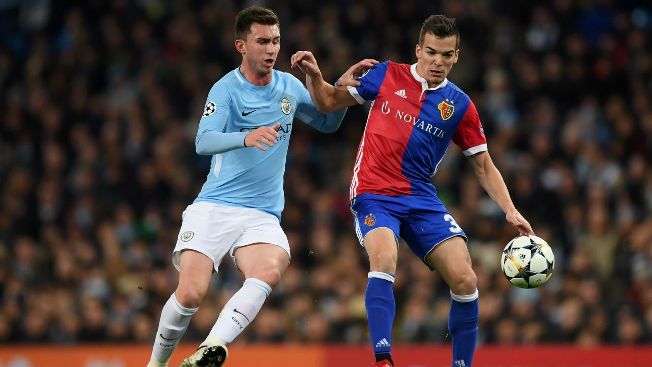 Aymeric Laporte of Man City vies for the ball with FC Basel's Kevin Bua in the Champions League.