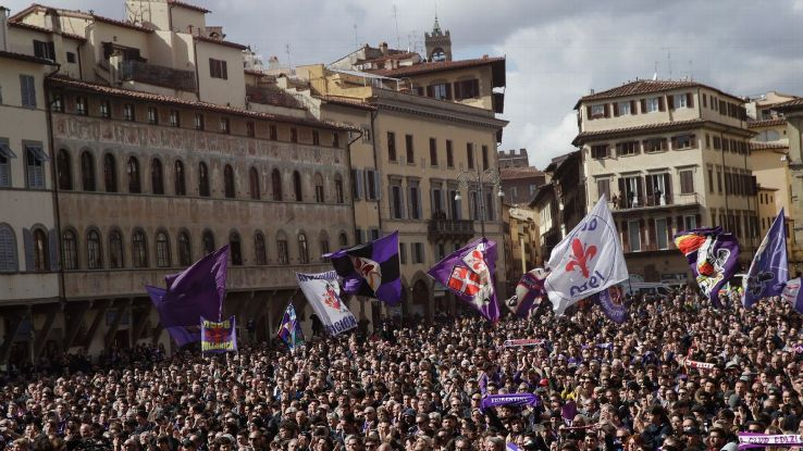 A city in mourning: People stand outside a church in Florence during the funeral ceremony of Davide Astori.